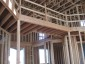 Photo of House under construction in the framing stage. Michael Luckado