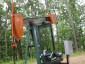 Photo of While deep-forest birds avoided gas-oil wells on the Allegheny National Forest, generalist species (such as the American robin whose nest is visible on this pump jack) increased with increasing well density. Scott Stoleson, USDA Forest Service