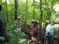 Photo of Students from the Agroforestry Academy learn about growing shiitake mushrooms on wood from a nearby timber stand improvement thinning. These students were a part of the August 2014 Agroforestry Academy held at Winona, MN. Richard Straight, USDA Forest Service