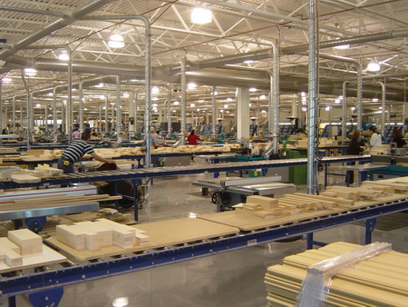 Photo of Hardwood parts for cabinet doors being manufactured in a U.S. woodworking facility. Urs Buehlmann, Virginia Polytechnic Institute and State University