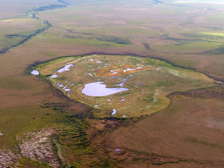 Photo of A drained tundra lake with remnant pools in northwest Alaska. USDA Forest Service