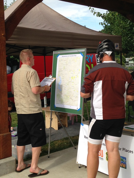 Photo of At a farmers' market in Carnation, Wash., members of the public identify some of their favorite places for outdoor recreation. USDA Forest Service