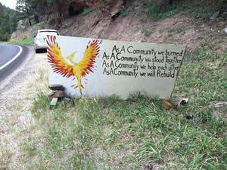 Photo of Community sign about rebuilding after the 2012 High Park Fire, Larimer County. USDA Forest Service