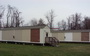 Photo of Exterior walls of test huts viewed from the southeast. Lance Barta, Home Innovation Research Labs