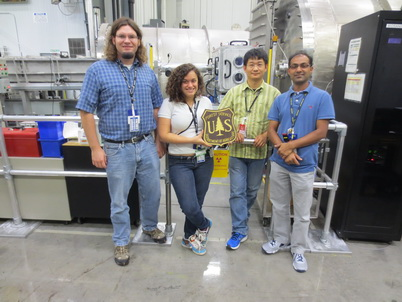 Photo of Forest Products Laboratory (FPL) and Oak Ridge National Laboratory (ORNL) researchers who performed small angle neutron scattering (SANS) experiments to study the effects of chemical modifications and moisture on the wood nanostructure at the ORNL High Flux Isotope Reactor Bio-SANS beamline. From left to right, Joseph Jakes (FPL), Nayomi Plaza (FPL), Shou Qian (ORNL), and Venky Pingali (ORNL). Joseph Jakes, U.S. Department of Agriculture Forest Service.