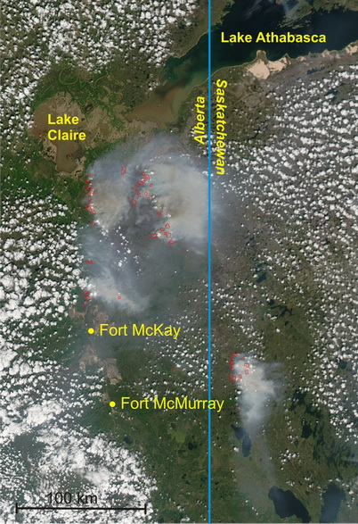 Photo of Smoke hangs over a large wildfire burning in the northeast corner of Alberta, Canada, in this natural color image taken by the Moderate Resolution Imaging Spectroradiometer (MODIS) on the Aqua satellite on June 8, 2011. Red outlines actively burning are NASA, MODIS Rapid Response Team. NASA, MODIS Rapid Response Team.