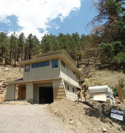 Photo of A home rebuilt after the 2010 Fourmile Canyon Fire, Boulder County. U.S. Department of Agriculture Forest Service.