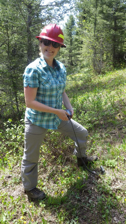 Photo of Autumn Coleman, soil scientist for the Helena National Forest, collecting soil moisture in the adjacent undisturbed forest. Joan Tirocke, U.S. Department of Agriculture Forest Service.