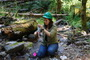 Photo of A researcher collects a water sample from a small stream in the H.J. Andrews Experimental Forest, Oregon. Rhonda Mazza, U.S. Department of Agriculture Forest Service.