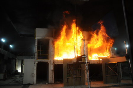 Photo of Flashover occuring during test 2 with a partially exposed CLT ceiling.