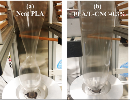 Photo of Image of blown films in lab scale tower showing unstable balloon (with die temperature at 160 degrees Celsius and (b) PLA/L-CNC-0.3 percent composite with stable balloon (with die temperature at 160 degrees Celsius).