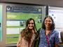 Undergraduate student Mareli Sanchez and her Forest Service mentor D. Jean Lodge in front of the award winning poster presented by Sanchez at the Mycological Society of America Meeting in Athens, Georgia.