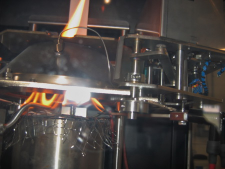 Photo of Flaming with special sample holder with thermocouples in the cone calorimeter test