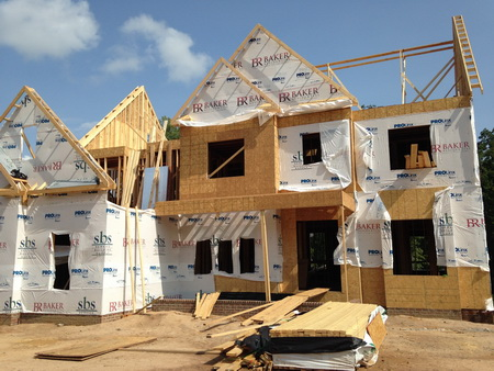 Photo of U.S. single-family house construction typically involves softwood framing lumber and structural wood-based panels, especially oriented strand board.