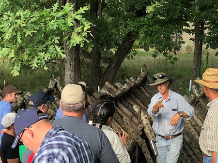 Photo of Silvopasturist and mushroom grower Greg Judy answers questions of the 2018 Missouri Agroforestry Academy Students.