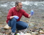 Photo of RMRS Research Ecologist Michael Schwartz collects eDNA samples from Rattlesnake Creek in Missoula, Montana. Photo credit Kellie Carim