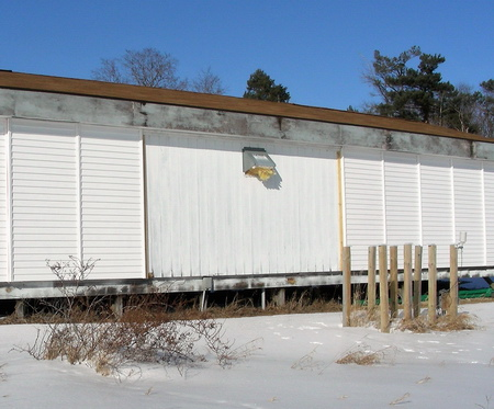 Researchers built a test hut with a variety of different exterior insulations and interior vapor retarders in order to test some common cases in the cold climate of Wisconsin. USDA Forest Service