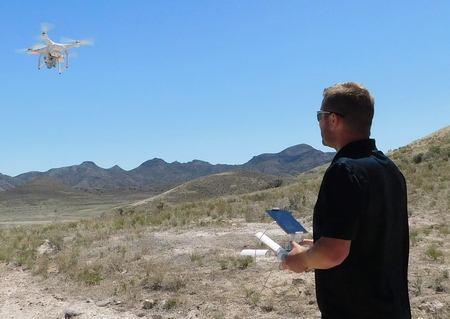 Researcher Kody Rominger, flying the DJI Phantom 3 Advanced drone, an economically priced quadcopter with a 12-megapixel camera, that was used to acquire imagery for the dwarf bear-poppy census.