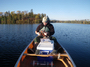 Photo of Trent Wickman of the Superior National Forest water sampling for mercury analysis.