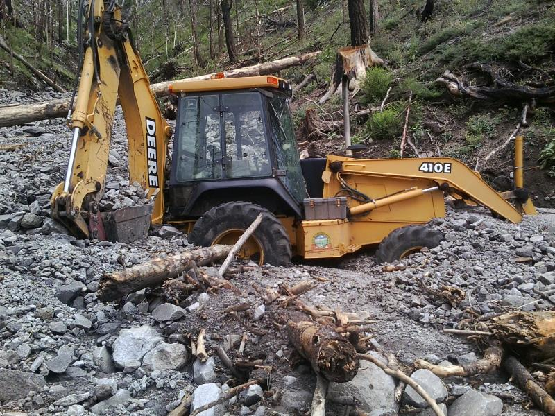 A backhoe partially buried by a debris flow after the Schultz fire on the Coconino National Forest in Arizona.