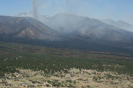 View of the Schultz Fire on June 24, 2010, with Timberline Estates in the foreground (photo by D. Fleishman, USDA Forest Service).