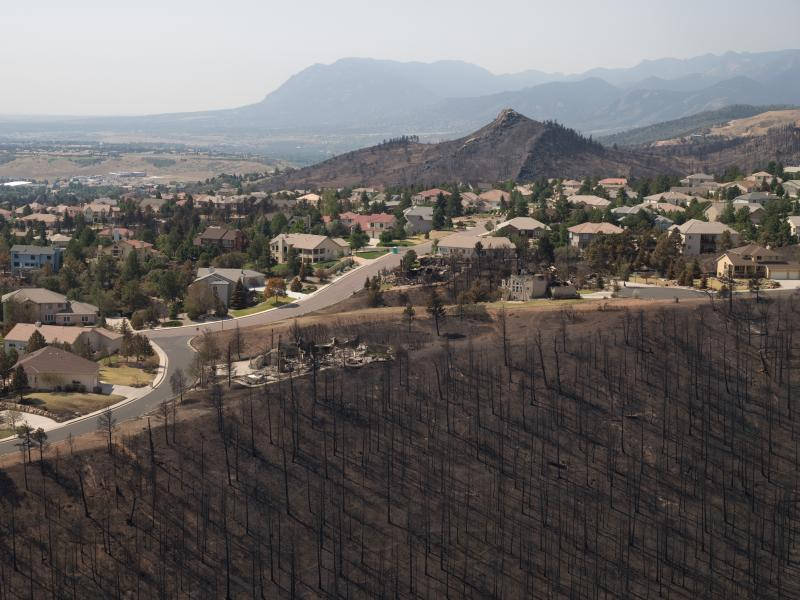 Damage from the 2012 Waldo Canyon Fire in a wildland-urban interface near Colorado Springs, Colorado (photo by Kari Greer, USFS).