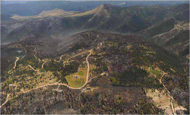 Aerial view of the Fourmile Canyon area. Steep slopes, dense ponderosa pine and Douglasfir forest, and mixed-land ownership characterize this wildland-urban interface zone near Boulder, CO. (Photo credit: Joe Amon, The Denver Post)