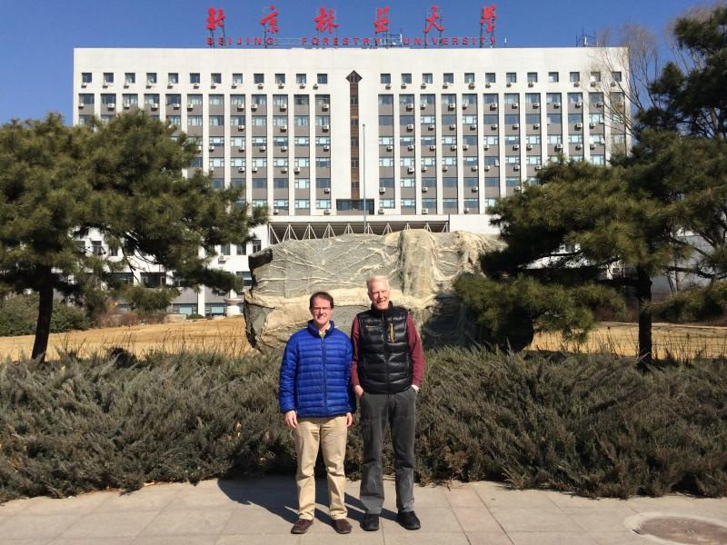 RMRS scientist Sean Healey (left) in front of Beijing Forestry University with Dr. Klaus von Gadow of that institution