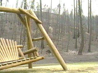 Wooden swing in the wildland urban interface.