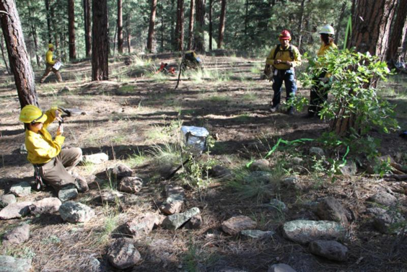 Fire crews and members of the Jemez Pueblo tribe install instrumentation near artifacts prior to the San Juan prescribed fire in New Mexico (photo by Dan Jimenez).