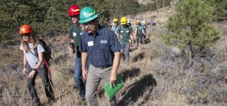 GTR-373 author Jonas Feinstein leads workshop participants into an untreated ponderosa pine and mixed conifer forest. All participants are wearing hardhats
