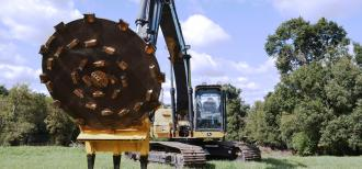 Heavy machinery with a large round mulcher