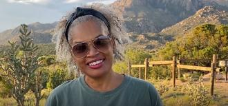 Photo of Paulette Ford with desert background.