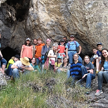The group visited a cave where they observed an ancient rat midden, as well as evidence of Native Americans (grinding stone), and native desert vegetation.