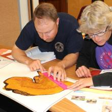 Teachers and agency fire specialists investigate fire scars and tree rings during the FireWorks master class. Photo by Ilana Abrahamson