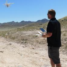 Kody Rominger flying the DJI Phantom 3 Advanced drone, an economically-priced quadcopter with a 12-megapixel camera, that was used to acquire imagery for the dwarf bear-poppy census.
