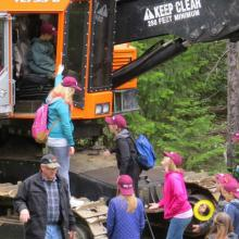 Students explore a forest harvester at the Priest River Expo.