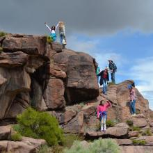 Students explore rocks containing Native American petroglyphs (photo by Stan Kitchen).