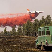 Airtanker and fire responder (photo Kari Greer)
