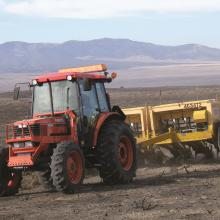 A rangeland drill in use - an example of the specialized seeding techniques under development for restoring sagebrush ecosystems following wildfire in the Great Basin, photo by Beth Newingham, USDA ARS
