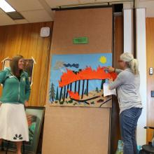 Educators telling the story of a crown fire burning a lodgepole pine forest. Photo by Ilana Abrahamson