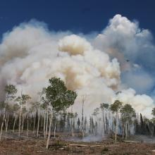 """Drones capturing smoke samples from small 100 acre """"knob"""" stand repacement prescribed burn 1 day prior to the Manning Creek burn (photo courtesy of Roger Ottmar, USFS Pacific Northwest Research Station)."""