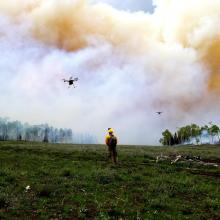 Drone takes off to sample smoke from the Manning Creek stand replacement fire (photo courtesy of Jesse Juchtzer, Desert Research Institute).