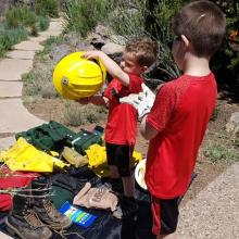 Children check out firefighting equipment at a Science Saturday fire awareness event celebrating National Fire Preparedness Day.