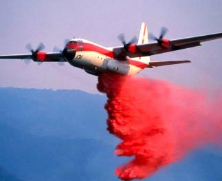 Large airtankers dropping fire retardant.
