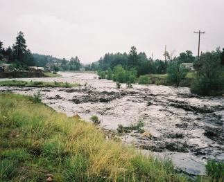Floods are natural disturbances that cause substantial erosion and movement of material around and between watersheds (photo by Dan Neary).