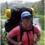 A photo of Emily Heyerdahl wearing backpacking gear