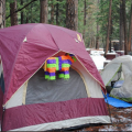 A tent with a pinata hanging outside.