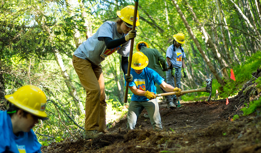 Workers performing trail maintenance