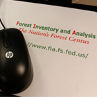 a photo of a mouse pad that reads forest inventory analysis